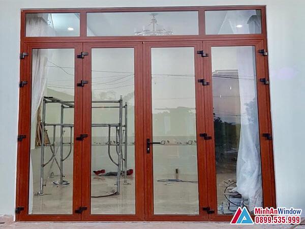 Cửa nhôm Xingfa 4 cánh vân gỗ đẹp cho các công trình - Minh An Window đã thi công